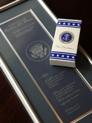 Chris Wofford has cooked for both presidents Bill Clinton and George W. Bush. Among some of his pieces of memorabilia from his exploits are a framed copy of the menu from a visit by president Clinton to the Ritz Carlton Hotel in Kansas City, Mo., and a box of M&Ms from Clinton.