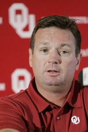 Oklahoma coach Bob Stoops answers a question at a news conference Tuesday in Norman, Okla. The Sooners will open the season Saturday against BYU in Arlington, Texas.