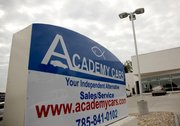 "The blackburns have a large ichthys, also known as a ""Jesus fish,"" on their Academy Cars signage at the company's new building, 1527 W. Sixth St."