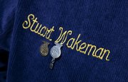 Two pins hang below Wakeman's name on his    official FFA jacket.