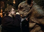 "Guillermo del Toro checks out one of the creatures during the filming of ""Hellboy II: The Golden Army."" The Oscar-nominated director recently published his first novel, ""The Strain."""