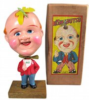 """""""Mr. Bighead"""" is a Japanese celluloid toy made before World War II. He is said to represent an American, while the insect on his head represents Japan. His eyes and mouth move. The mint in-the-box toy sold at Keith Spurgeon's Mosby & Co. Auctions in Frederick, Md., for $3,191."""
