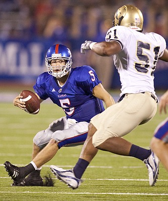 Kansas quarterback Todd Reesing puts a move on Northern Colorado linebacker Cameron Friend during the third quarter Saturday, Sept. 5, 2009 at Memorial Stadium.