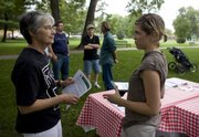 Dana Hangauer, Lawrence, right, chats with state Sen. Marci Francisco, D-Lawrence, Monday at a potluck Hangauer organized in South Park.