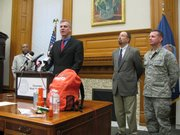 PREPAREDNESS MONTH -- Gov. Mark Parkinson speaks Tuesday during Capitol news conference, urging Kansans to be prepared for emergencies, including H1N1 flu pandemic. From left to right behind him are Kansas Department of Health and Environment Secretary Roderick Bremby, State Health Officer Dr. Jason Eberhart-Phillips and Maj. Gen. Tod Bunting, director of the Kansas Division of Emergency Management and the adjutant general.