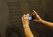 A woman takes a photo of a plaque that honors the victims of Flight 93 that was unveiled Wednesday at the U.S. Capitol in Washington.