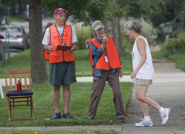Phil Minkin, left, and Carey Maynard-Moody volunteered to count passing bicyclists and pedestrians in 2009 at Ninth and Louisiana streets. The two were part of a volunteer team monitoring 11 sites around Lawrence to help generate data to support the city's efforts in grant applications for future bicycling and pedestrian projects.