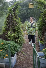 Joyce Blair, a resident at Babcock Place, oversees the residents' vegetable garden, which produces fresh tomatoes, red peppers and other produce.