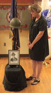 Judith Dietz reflects on the military service of her father, Platoon Sgt. Glenn E. Nicholson, who was killed while serving in the Vietnam War 41 years ago. Nicholson, a former Kansas University ROTC instructor, was honored during a ceremony Thursday at KU's Military Science building. Dietz, one of Nicholson's eight children, helped plan the ceremony with Army Lt. Col. John Basso, a KU military science professor.