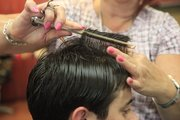 Brenda Smith-Peterson of Hair Experts in Lawrence encourages men to bring in photos or look through style books at the hair salon to give the stylist a visual starting point.