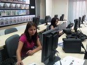 Students at the New York Institute of Technology campus in Amman, Jordan, work in a computer lab as part of a digital photography class taught by Lawrence artist Henri Doner-Hedrick. Doner-Hedrick is beginning her second year at the school.