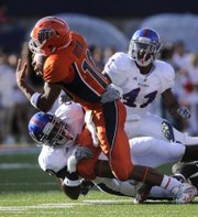 Kansas defensive end Maxwell Onyegbule pulls down UTEP quarterback Trevor Vittatoe for a sack during the first quarter Saturday, Sept. 12, 2009 at the Sun Bowl in El Paso, Texas.