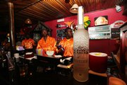Bartenders prepare drinks Aug. 15 at the Caliente Bar in Lagos, Nigeria. Most of Nigeria's 150 million citizens may live in poverty, but the West African oil giant is also home to a fabulously flamboyant elite.
