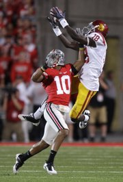 USC wide receiver Damian Williams (18) goes up for a reception against Ohio State defensive back Devon Torrence (10). USC held off Ohio State, 18-15, on Saturday in Columbus, Ohio.