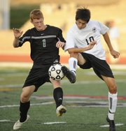 Free State's Diego Gonzalez (10) and De Soto's Sammy Seibolt vie for the ball. Free State defeated De Soto, 2-0, on Monday at Free State High.