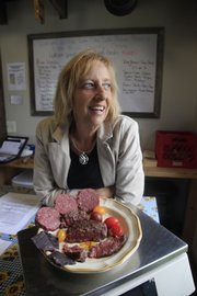 Terri Gibbs is shown with the different cuts of meat sold through her family's business, Lone Star Lake Bison Ranch, located in Overbrook. Bison meat is a lower-fat red meat alternative and versatile in a variety of dishes.