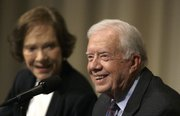 "Former President Jimmy Carter is flanked by his wife, Rosalynn, as he speaks Tuesday during ""Conversations at the Carter Center"" in Atlanta."