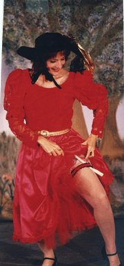 "Jeanne Averill performs in ""Dangerous Damsels"" in 1996 at the Apple Valley Farms Theatre."