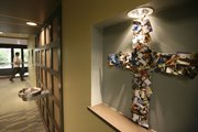 A cross made of credit cards that radio listeners and television viewers have sent Dave Ramsey is displayed in Ramsey's Lampo Group headquarters in Brentwood, Tenn.