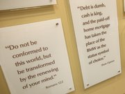 Quotes from Dave Ramsey are displayed along with Bible verses in the lobby of Ramsey's Lampo Group headquarters in Brentwood, Tenn.
