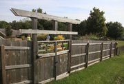 A fence offers privacy to the Harmons' property in northwest Lawrence.