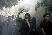 An Iranian female opposition supporter reacts as she attends a protest Friday in Tehran, Iran, in competition with government-sponsored mass rallies to mark an annual anti-Israel commemoration, the Quds Day that reflects the Persian nation's sympathy with the Palestinians.