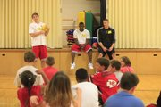 KU basketball players, from left, Jordan Juenemann, Mario Little and Cole Aldrich spend some time with students at Sunset Hill Elementary School on Tuesday, Sept. 22, 2009 during a gym class. The players exercised with the kids and stressed habits promoting good health.