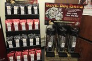 Hank Salmans of Devil Dog Brew in Lawrence has set up displays of bagged coffee and carafes of fresh brew in various local locations to try to promote his product.