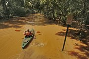 John Knox takes his kayak back to his house on Paces Ferry Drive as he ferried supplies Tuesday to and from his house, which is under 5 feet of water in Vinings, Ga. The Chattahoochee River's level near Vinings was at 27.36 feet before daybreak Tuesday after cresting at 28.1 feet overnight, the second highest on record, exceeded only by a crest of 29 feet in 1919.