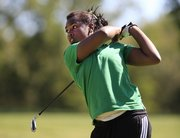 Free State's Bethany Cobbs hits a drive Thursday at the Lawrence Invitational at Alvamar County Club. Cobbs carded a 128 on the day.