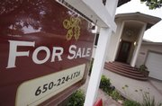 A home is for sale Thursday in Palo Alto, Calif. Home resales dipped unexpectedly last month after a four-month streak of gains, providing evidence that the housing market recovery remains fragile.