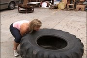 Diane Bannerman Juracek flips a tractor tire during strongwoman competition practice.