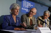 Kathleen Sebelius, secretary of Health and Human Services, from left, talks with Mayo Clinic Vaccine Research Group Director Dr. Gregory A. Poland and American Academy of Pediatrics President Dr. David T. Tayloe at the National Press Club in Washington in this Sept. 10 file photo. An unprecedented system to track possible side effects from swine flu vaccinations will begin next month.