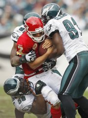Kansas City Chiefs quarterback Matt Cassel, center, is tackled by Philadelphia Eagles defensive ends, clockwise from lower left, Trent Cole, Darren Howard and Chris Clemons in the second quarter Sunday in Philadelphia. The Chiefs lost, 34-14, the latest setback in another season where the losses are piling up.