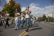 The annual LHS homecoming parade snaked its way from South Park down Mass Street to 19th Street and then west to the school. Members of the LHS marching band lead the way.