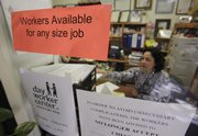 Maria Marroquin helps find jobs for unemployed workers Friday at the Day Worker Center of Mountain View, in Mountain View, Calif. The unemployment rate rose to 9.8 percent in September, the highest since June 1983, as employers cut far more jobs than expected.