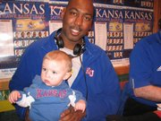 "Manning Urish met Danny Manning in January 2008 at a ""Hawk Talk"" event at the Salty Iguana in Lawrence. Manning was 1 year old at the time. He also has an autographed basketball from his Jayhawk namesake."