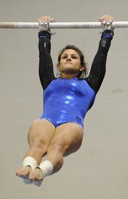 Free state high's Drue Davis eased her way through the bars on Monday, finishing fourth in the LHS All-Around Invitational at Lawrence High.