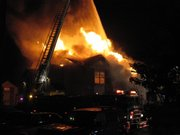 Flames engulf an Aberdeen South apartment building shortly after 6:30 a.m. Thursday, October 8, 2009.