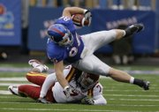 Kansas tight end Tim Biere gets taken off his feet in the fourth quarter of the Kansas and Iowa State game Saturday.