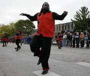 KU alum Darian Nade performed with the Gateway Highsteppers Drill Team during the homecoming parade Saturday on Jayhawk Boulevard.