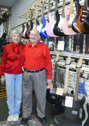 Bernice and Marion Kutz, pictured in their store in Pittsburg, are celebrating their 60th wedding anniversary and the 50th anniversary of their business, Kutz Music. They were married in Parsons in 1949 and also opened their first shop there in1959.