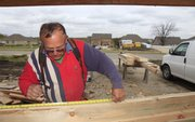 Paul Bittinger frames a home Monday at 317 Carver Lane. Just weeks ago, Bittinger couldn't find work in construction, but a turn in the economy has put him back in business. Some think the local market has been helped significantly by the federal government's $8,000 first-time homebuyers' credit.