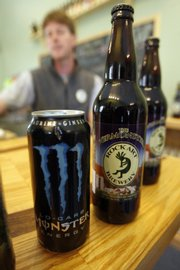 Matt Nadeau displays a can of Monster energy drink and a bottle of Vermonster beer at his Rock Art Brewery in Morrisville, Vt. Nadeau has been told by Hansen Beverage Co., the maker of Monster energy drinks, to stop selling the brew.