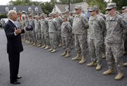 Vice President Joe Biden greets members of the Delaware Army National Guard 261st Signal Brigade in Dover, Del., before an official welcome home ceremony after the unit's deployment in Iraq in this Sept. 30 photo. Biden's to-do list was defined at the outset by two issues central for President Barack Obama: keeping the U.S. on track to get out of Iraq and making sure that hundreds of billions of economic stimulus dollars are spent swiftly and smartly.