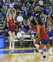 Nicole Tate (13) sets up Brittany Williams and Tayler Tolefree (5). Kansas was swept, 3-0, by Texas on Wednesday in Horejsi Family Athletic Center.
