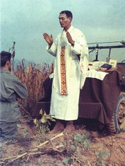 Father Emil Kapaun, a Catholic priest and Army chaplain, says Mass in the field during the Korean conflict in this undated photo released by the Catholic Diocese of Wichita. Kapaun, already under consideration for sainthood, has won the endorsement of the Army's top civilian leader to receive the Medal of Honor.