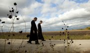 David Bawden and seminarian Phil Friedl walk the country road to the farmhouse.