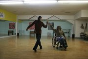 Lorraine Cannistra, Lawrence, dances with Chris Pruitt, owner of Bella Performing Arts Studio, as part of the Groovability dance troupe.