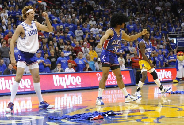 Jeff Withey, left, Xavier Henry, center, and Elijah Johnson dance during a freshman skit at the 2009 Late Night in the Phog.